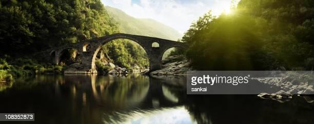 Panoramic shot of ancient bridge over river