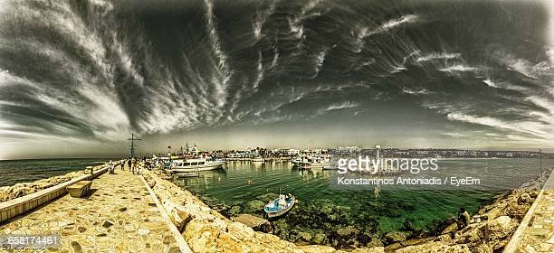 Panoramic Shot Of Boats In Calm Sea Against Cloudy Sky