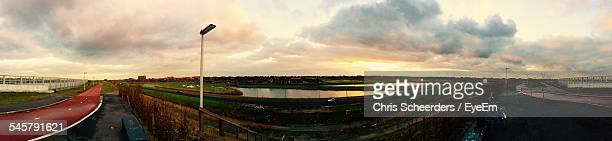 Panoramic Shot Of Canal Against Sky During Sunset