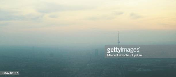 Panoramic Shot Of Fernsehturm In City Against Sky During Foggy Weather