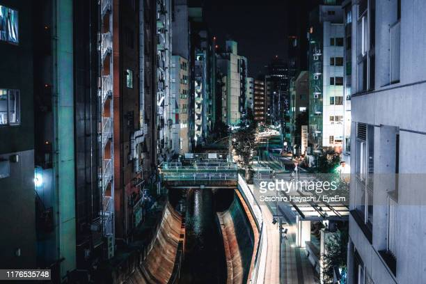 panoramic shot of illuminated buildings in city at night - seiichiro hayashi ストックフォトと画像