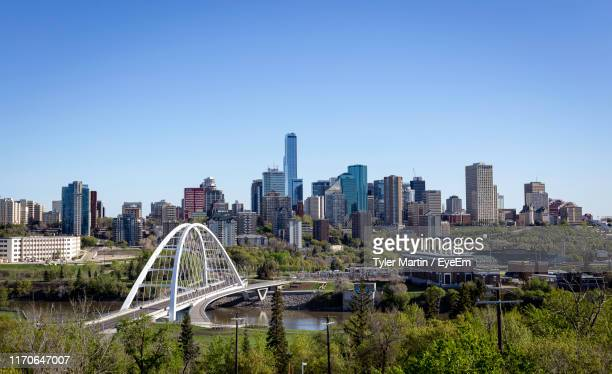 panoramic shot of modern buildings against clear sky - edmonton stock pictures, royalty-free photos & images