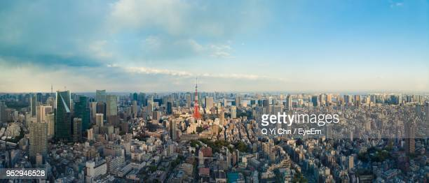 panoramic shot of modern buildings in city against sky - 東京 ストックフォトと画像