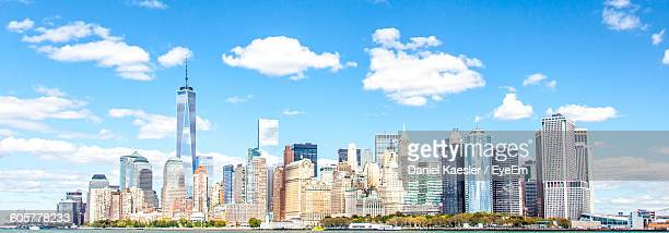 Panoramic Shot Of Modern City Skyline Against Sky