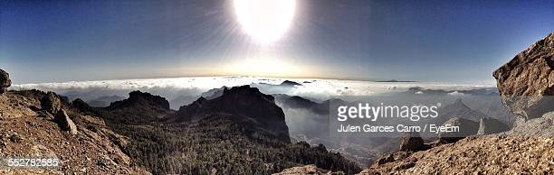 panoramic shot of mountains covered with fog on sunny day - tejeda canary islands stock pictures, royalty-free photos & images