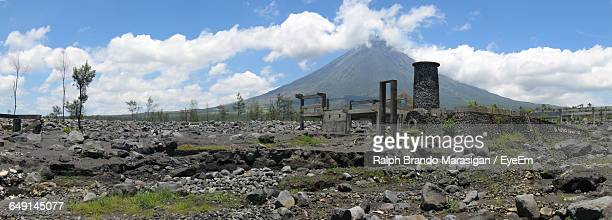 Panoramic Shot Of Old Ruins With Mayon Volcano In Background