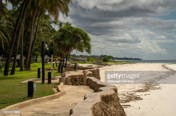 panoramic shot of palm trees on diani beach and building  against sky - mombasa stock pictures, royalty-free photos & images
