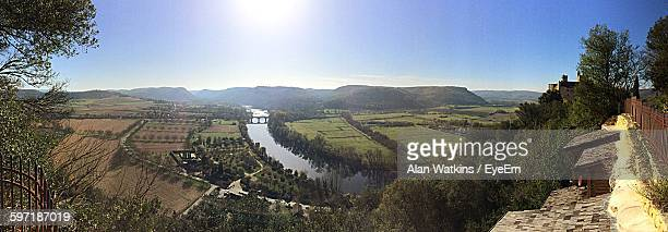 Panoramic Shot Of River Amidst Agricultural Field Against Clear Sky