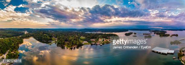 panoramic shot of river and cityscape against sky - chattanooga stock pictures, royalty-free photos & images
