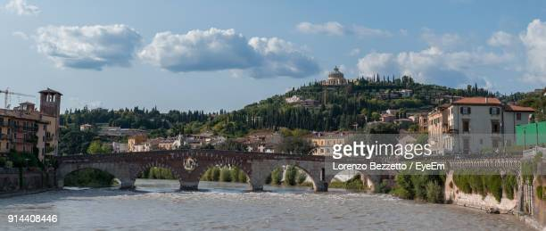 panoramic shot of river in town against sky - verona arena foto e immagini stock