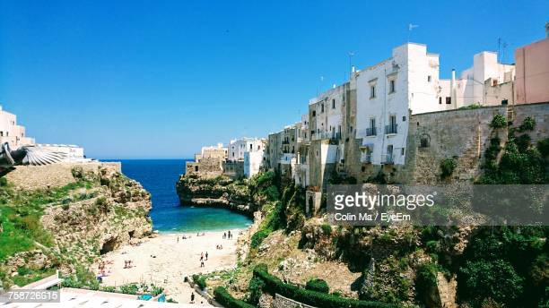 panoramic shot of sea against clear blue sky - polignano a mare stock photos and pictures