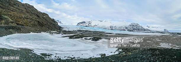 panoramic shot of skaftafell national park against cloudy sky - ignatius tan stock photos and pictures