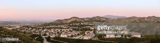 panoramic shot of townscape by mountains against sky - santa clarita stock pictures, royalty-free photos & images