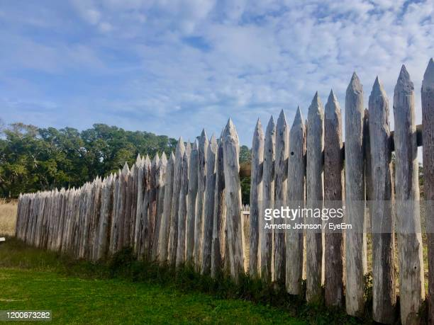 panoramic shot of wooden fence on field against sky - annette haven foto e immagini stock