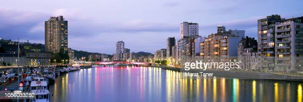 panoramic skyline view of liege at dusk - liege stock pictures, royalty-free photos & images