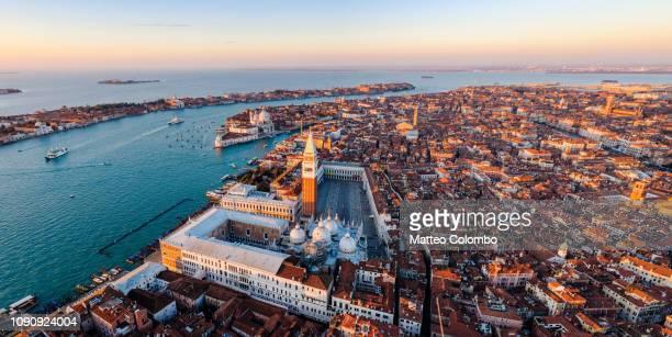 panoramic sunrise over venice, aerial view - basilica di san marco foto e immagini stock