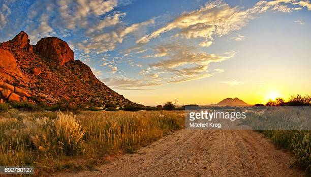 a panoramic sunset landscape photo of spitzkoppe in namibia, erongo, namibia - erongo stock photos and pictures