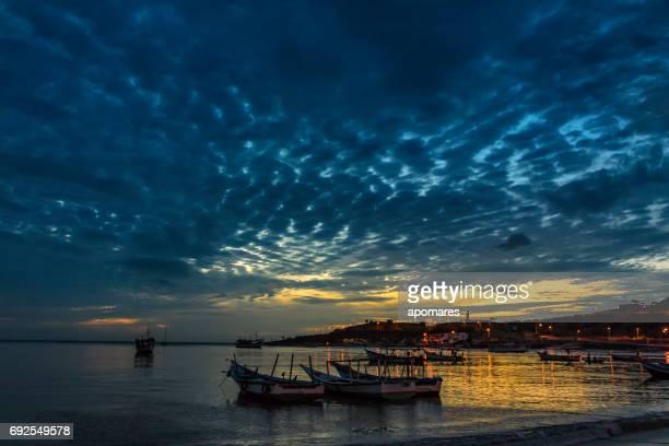 panoramic sunset view of fishermen´s  boats at juan griego bay, margarita island, venezuela - margarita beach stock photos and pictures
