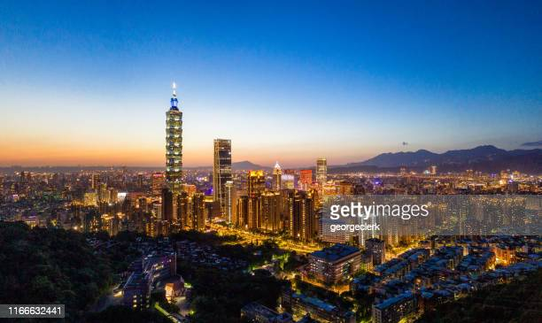 panoramic taipei cityscape at dusk - taipei stock pictures, royalty-free photos & images