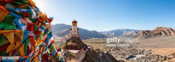 Panoramic: tibetan prayer flags and valley, Tibet