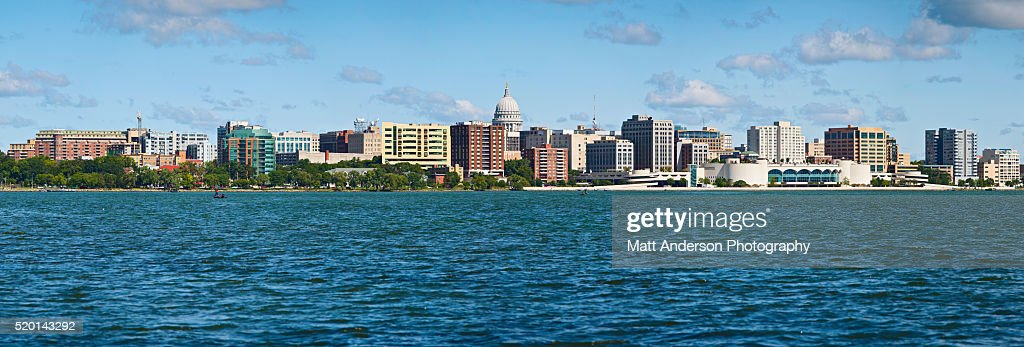 Panoramic USA, Wisconsin, Madison, City skyline over Lake Monona Taken from Lake Monona, Madison's granite capitol building accents the city's skyline. : Stock Photo