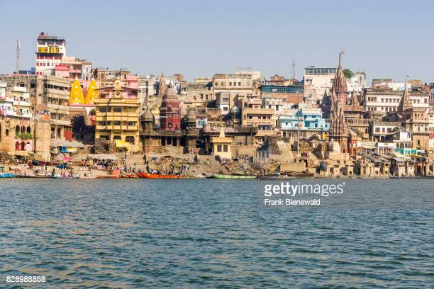 Panoramic view across the holy river Ganges on Manikarnika Ghat Burning Ghat in the suburb Godowlia