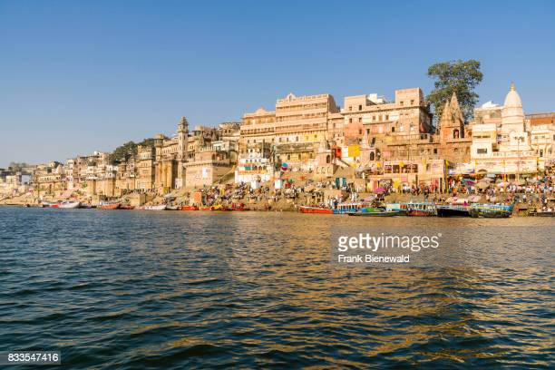 Panoramic view across the holy river Ganges on Munshi Ghat in the suburb Godowlia.