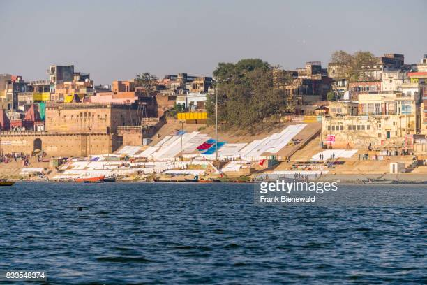 Panoramic view across the holy river Ganges on Pandey Ghat in the suburb Godowlia