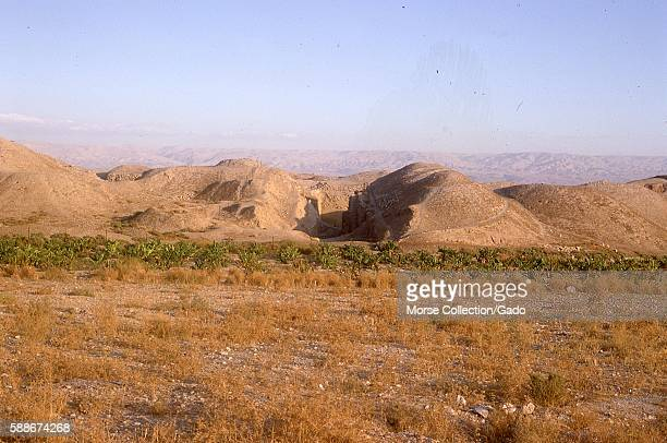 Panoramic view facing east of the hills and vegetation outside the city of Jericho West Bank Israel November 1967