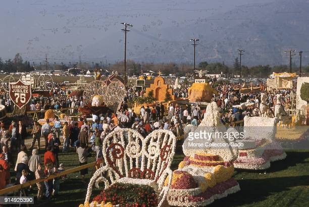 Panoramic view facing north of floats parked at the public display showcase following the 1956 Tournament of Roses Parade in Pasadena California 1956...