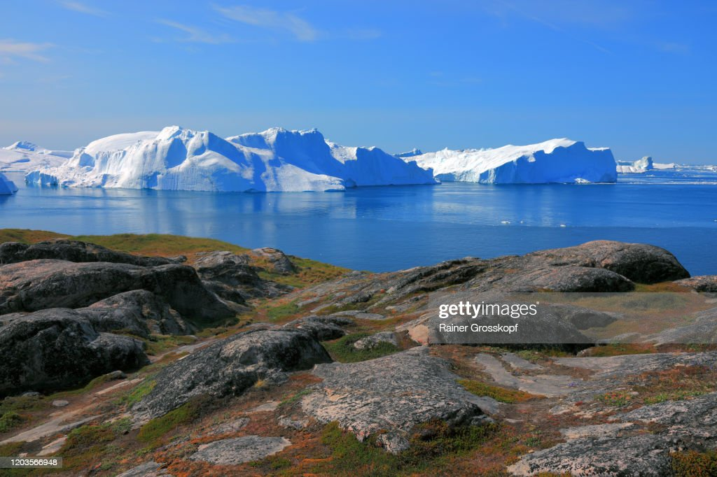 Panoramic view from a rocky mountain at huge icebergs in the Icefjord : Stock-Foto
