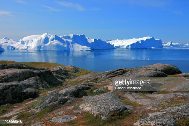 panoramic view from a rocky mountain at huge icebergs in the icefjord - rainer grosskopf stock-fotos und bilder