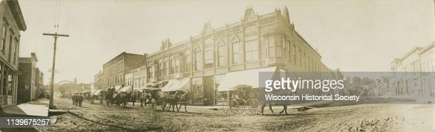 Panoramic view from street of Martin Lein/Lien's funeral procession showing Main and Water Streets before the flood of 1911 Black River Falls...