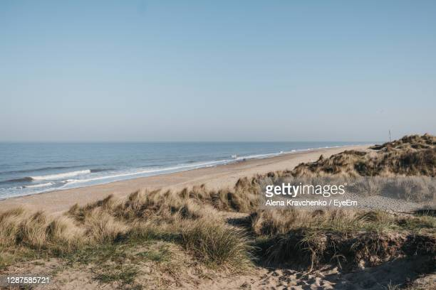 panoramic view from the hill over hemsby beach, norfolk, uk, on a sunny spring day. - beach stock pictures, royalty-free photos & images