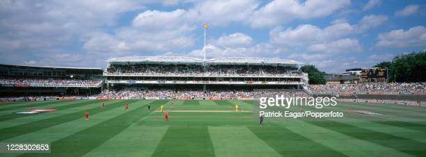 Panoramic view from the Tavern Stand across the ground towards the new Grand Stand as Henry Olonga of Zimbabwe runs in to bowl to Mark Waugh of...