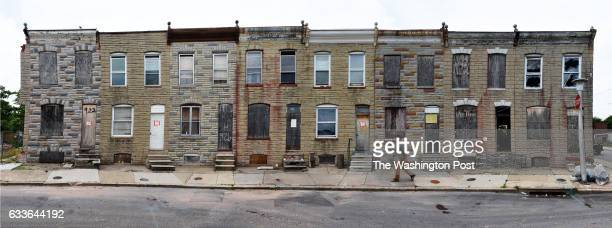 Panoramic view of a row of houses on NBradford street slated for demolition on June 2016 in Baltimore MD