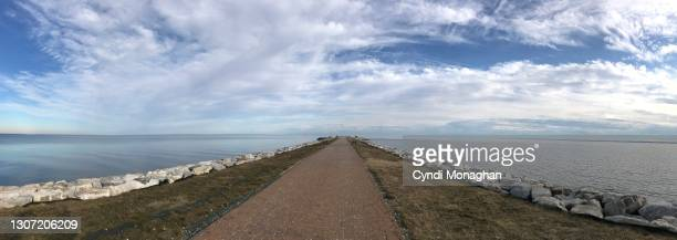 panoramic view of a walkway leading to the chesapeake bay, north point state park - maryland us state stock pictures, royalty-free photos & images