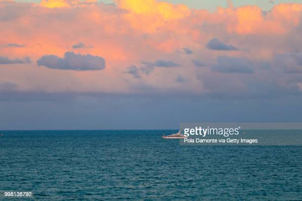 Panoramic view of a yacht in the caribbean sea at sunset