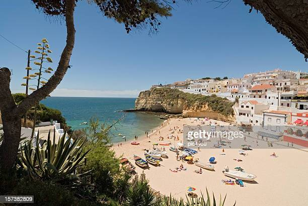 panoramic view of algarve overlooking a beach on a sunny day - algarve stock photos and pictures