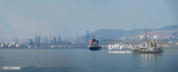 Panoramic view of Aliaga oil refinery with anchored ships.