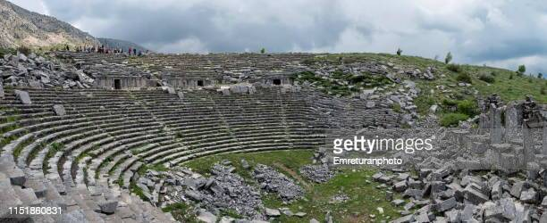 panoramic view of ampitheater in sagalassos. - emreturanphoto stock pictures, royalty-free photos & images