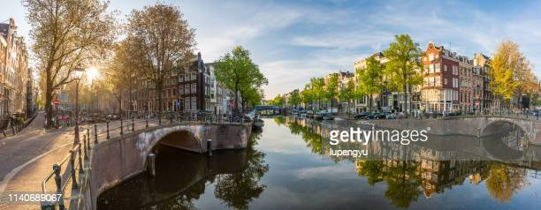panoramic view of amsterdam at sunrise - amsterdam stock pictures, royalty-free photos & images