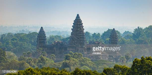 panoramic view of angkor wat from phnom bakheng - angkor wat stock pictures, royalty-free photos & images