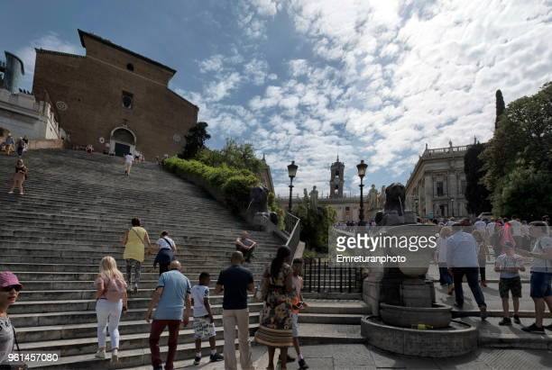 panoramic view of aracoeli steps and cordonata steps full of tourists at capitolino,rome. - emreturanphoto stock pictures, royalty-free photos & images