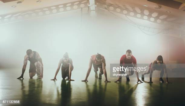 panoramic view of athletes preparing for sports trace. - contest stock pictures, royalty-free photos & images