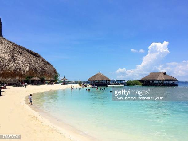 panoramic view of beach against blue sky - cebu stock photos and pictures