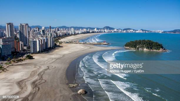 panoramic view of beach against clear blue sky - são paulo city stock pictures, royalty-free photos & images