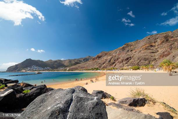 panoramic view of beach against sky - tenerife stock pictures, royalty-free photos & images