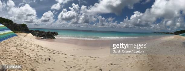 panoramic view of beach against sky - sarah sands stock pictures, royalty-free photos & images