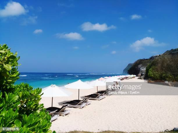 panoramic view of beach against sky - denpasar stock pictures, royalty-free photos & images